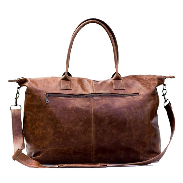 Unique fabric lining Inside pocket & zipped outer pocket Double carry handles Removable & adjustable leather shoulder strap Metal feet underneath for protection Hand crafted in South Africa Finest hand selected distressed bovine leather L 65cm x H 40cm x W 25cm Delivery within 3 - 5 working days