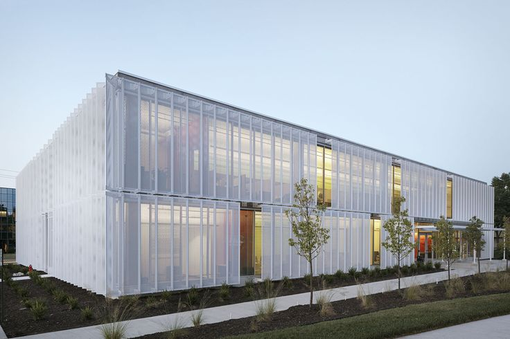 Kansas heat is no match for this moving facade of perforated screens