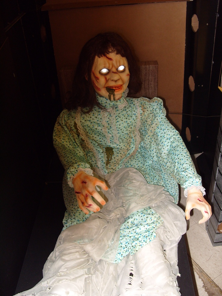 Linda Blair Exorcist prop with glowing eyes at Spirit of Halloween store.