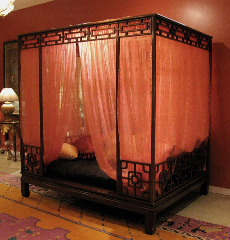 1stdibs | Exotic Chinese 4-Poster Bed  P print      F save        E email           «  1   «  0    Exotic Rosewood Ming Style 4-Poster Chinese Bed with sheer embroidered hangings & open fretwork panels. The bed comes with a stuffed mattress that is smaller than the bed size (pillows not included).
