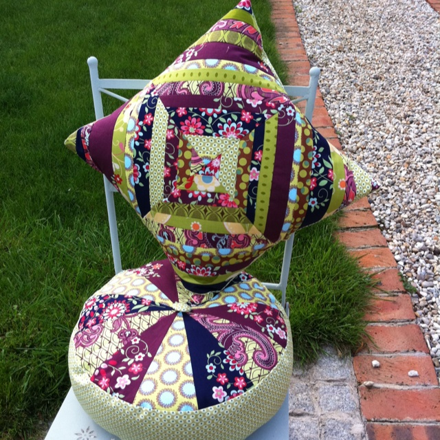 Two scrappy cushions. Sprocket pillow from Cluck Cluck Sew and scrappy string.