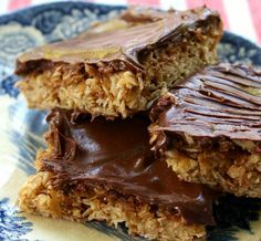 These Oh Henry bars are an old recipe that is is just as good today and in 1965. Crunchy sweet oatmeal base covered with peanut butter chocolate ganache