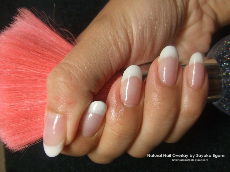 """These are the perfect nails... almond-shaped without being too pointed, and not too long. And I think this actually might be an """"American"""" manicure rather than a """"French"""" manicure, because the white part isn't so insanely white like French often is. These nails are totally perfect."""