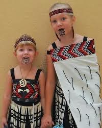 two children wearing taniko patterns