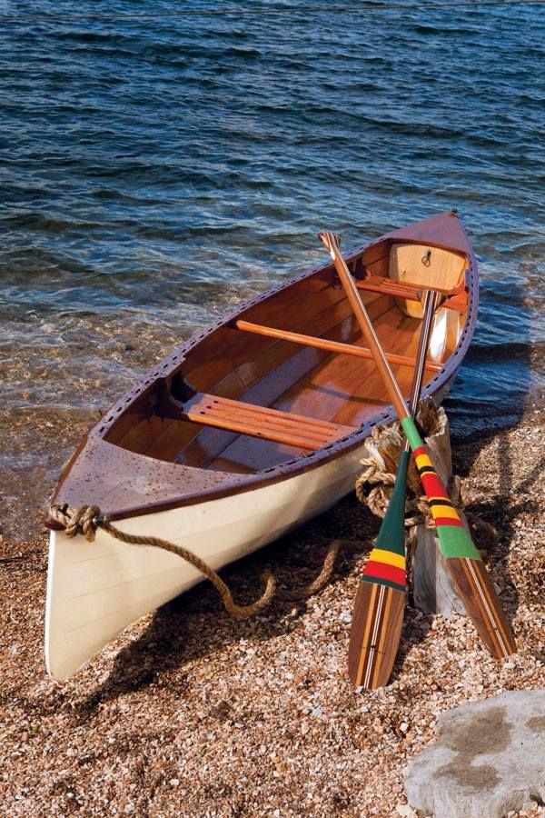 Beautiful wood canoe and paddles