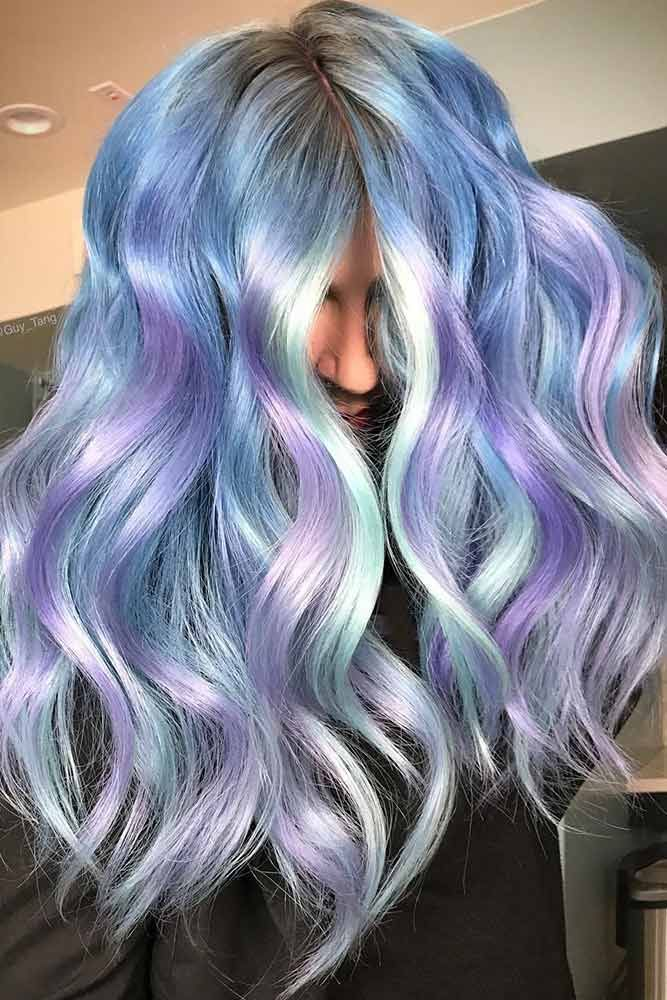 Are you excited about the mermaid hair trend so much that you cannot wait until next time you go to the hair salon? We have a photo gallery featuring sea-reminiscent, fantastic masterpieces for your inspiration. Check it out! #haircolor #mermaidhair #longhair #wavyhair