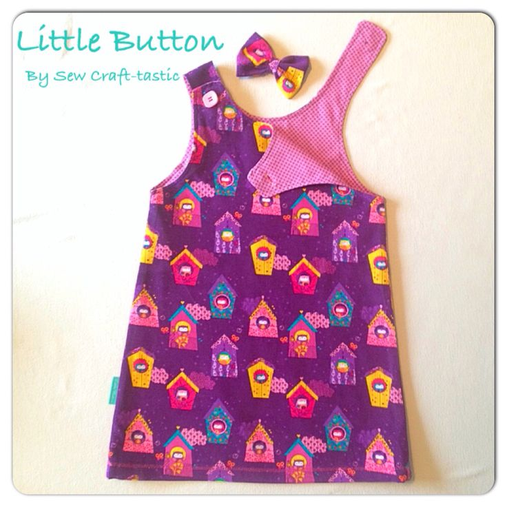 A-line pinafore in soft warm needle cord in deep purple, with owl print in birdhouses. Www.facebook.com/SewCraft-tastic