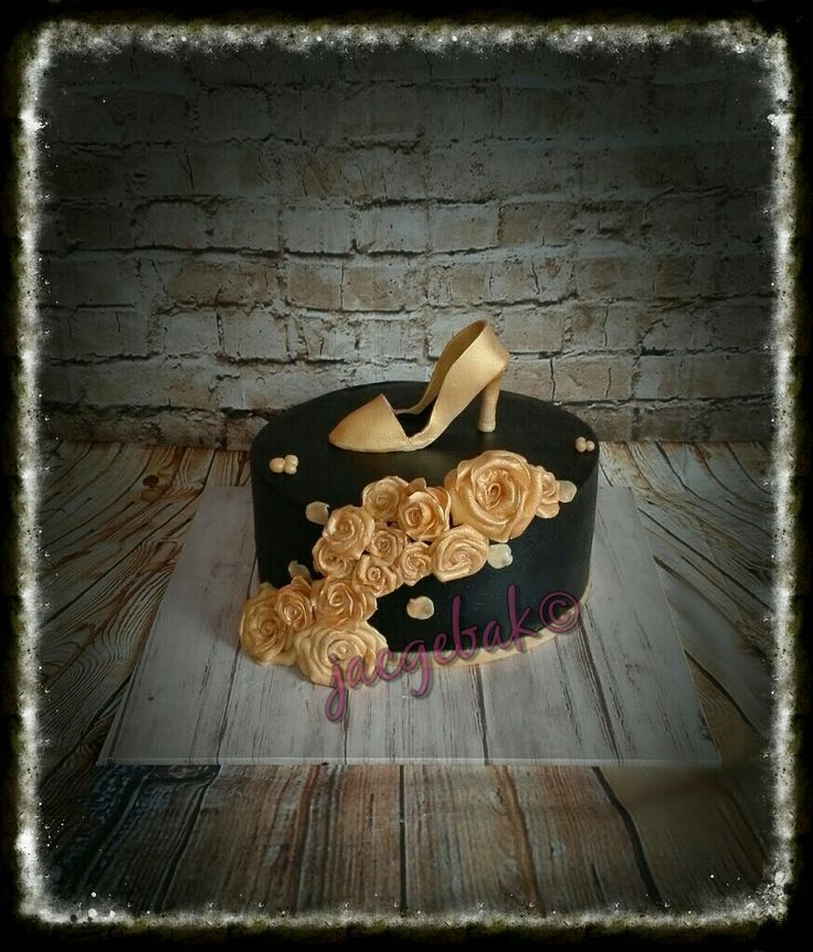 Black and Golden cake with pump and roses