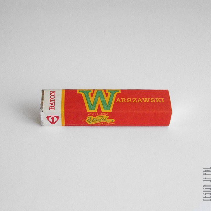 """1966, ZPC im. 22 Lipca dawniej E. Wedel, obwoluta dla batona """"warszawskiego"""", autor projektu: Karol Śliwka.  informacje z opakowania:  • SKŁAD: ziarno kakaowe, cukier, syrop ziemniaczany, mleko, tłuszcz cukierniczy. Aromatyzowany.  • netto 45g  •..."""