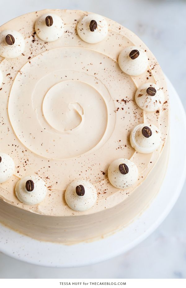 Caramel Cappuccino Cake - espresso cake paired with caramel buttercream frosting, topped with whole coffee beans and a sprinkle of cocoa powder | by Tessa Huff for TheCakeBlog.com