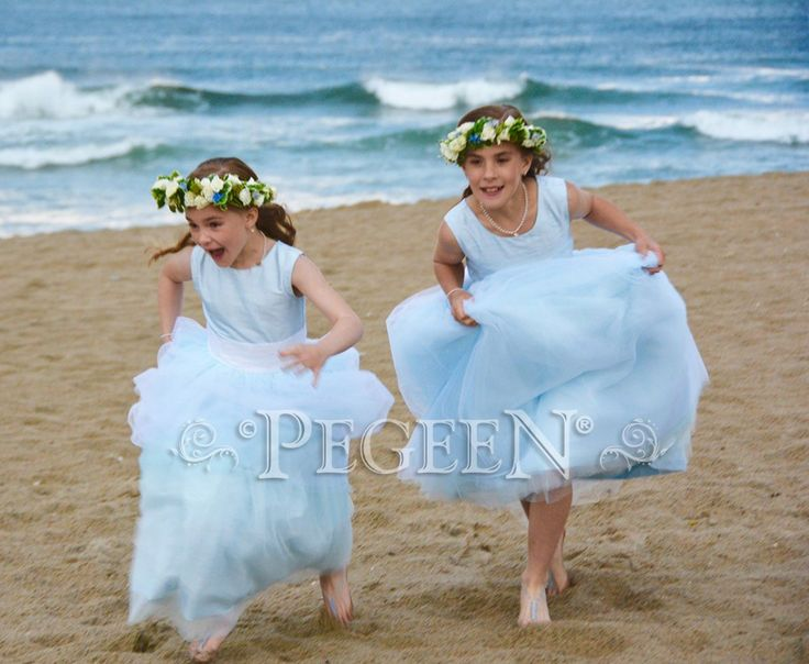 Flower Girl Dress of the Month - May 2017 features a beautiful blue and yellow beach wedding available in all sleeve lengths and in 200 silk colors by Pegeen.com