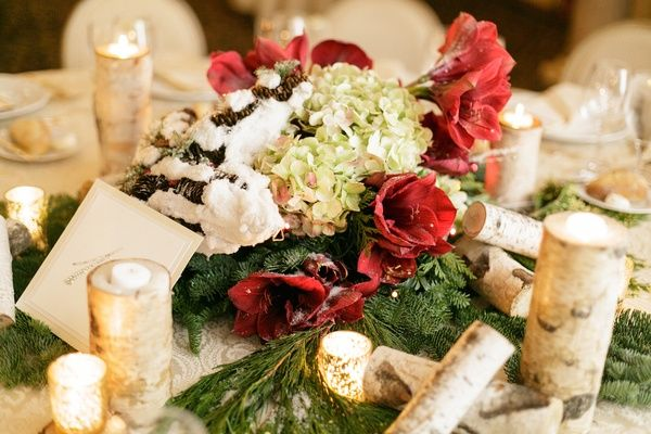 ... Winter wedding centerpiece of evergreen, red amaryllis, green hydrangeas, fake snow on pinecones · Holiday wedding reception table ...