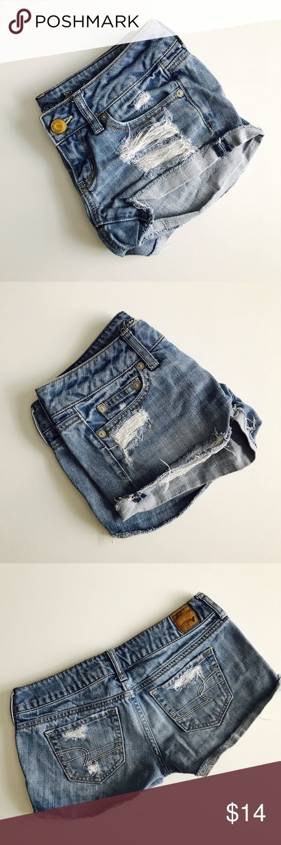 "American Eagle denim shorts. Good used condition. Were purchased this way, NOT homemade. Light denim wash (slightly lighter blue than pictured). Size 0. 3"" inseam (shorter when cuffed). Waist approx 15"" flat across. Price is firm unless bundled. Sorry, no trades & I am unable to model. American Eagle Outfitters Shorts Jean Shorts"
