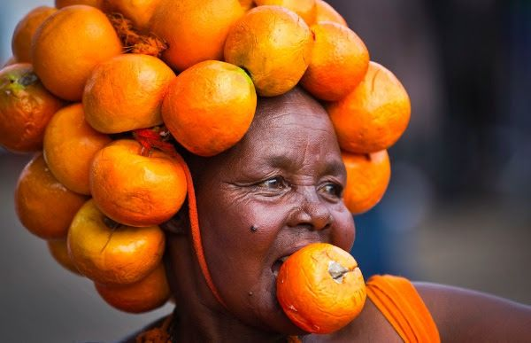 A supporter of Kenyan opposition leader Raila Odinga's Orange Democratic Movement (ODM) party wears a head-dress made of oranges, the party's color, as she attends a rally to welcome Odinga back to the country. Credit: AP: Ben Curtis