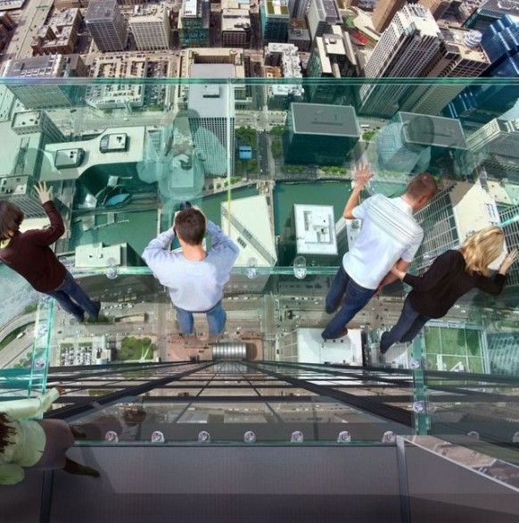 Makes me nervous just looking at this picture - This tallest skyscraper in the United States has four glass box viewing platforms. These balconies are suspended 1,353 feet (412 m) in the air on the 103rd floor.