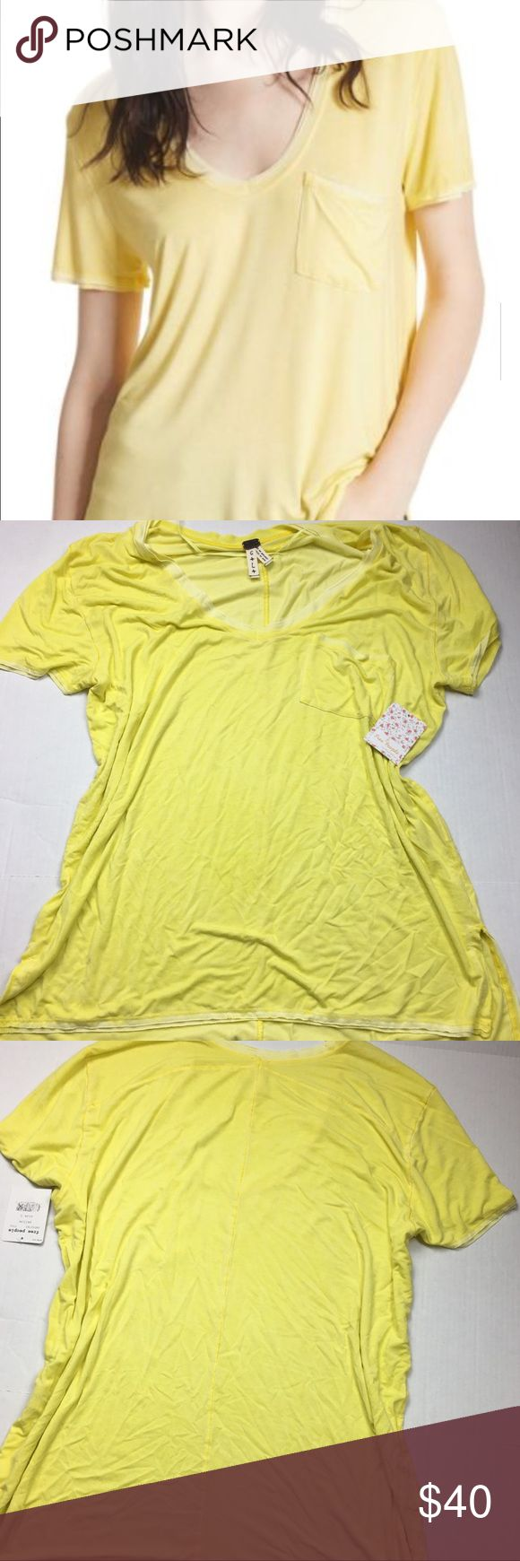 NWT Free People Rising Sun Tee Free People We the Free Rising Sun Tee. Size Large. New with tags! Hazy yellow Slouchy Tee with front pocket and exposed seams. Scoop neck. Short sleeves. Rayon/Spandex blend. Very slouchy and oversized. Super soft and the perfect basic for all wardrobes! Free People Tops Tees - Short Sleeve