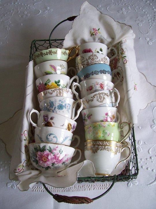 CUTE way to store vintage tea cups until your girlfriends come by or for a garden party.... keep them with a pretty hankie or tea towel in a cute caddie basket Alice in Wonderland