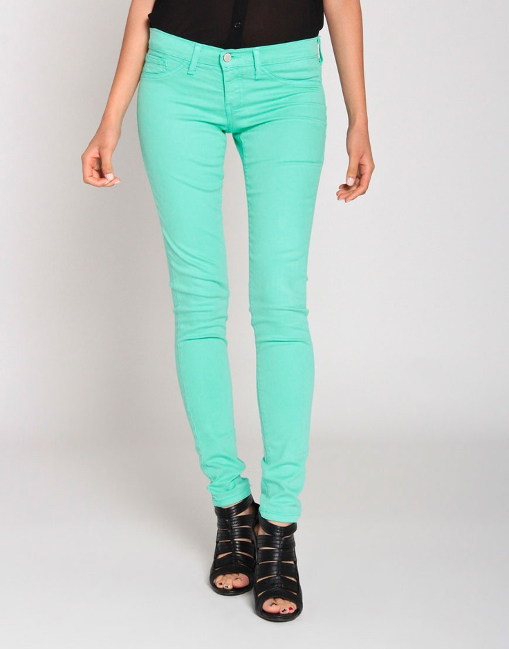 aqua. The style today has many pops of color.  Aqua pants would be a greate purchase because they work for all seasons.