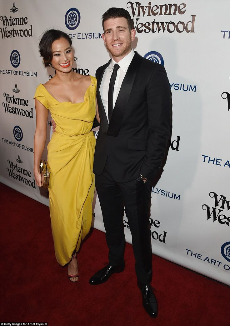 Not so mellow yellow: Jamie Chung delighed in her yellow gown alongside husband Bryan Greenberg