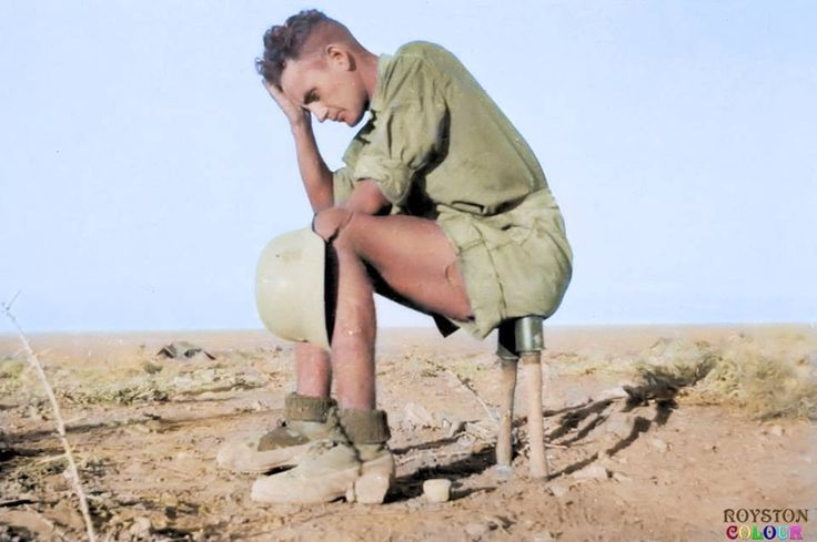 A Deutsche Afrika Korps (DAK) trooper balanced precariously on two M24 Stielhandgranates (Hand Grenades) somewhere in the North African Desert ca.1942/3  The grenades wouldn't have detonated without the end cap removal and the internal cord being pulled but still a dangerous choice of seating, we think.  (Colourised by Royston Leonard from the UK)