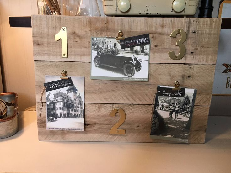 Rustic Wood Pallet Wall Picture Holder/Organizer by MadeAndFoundDecor on Etsy https://www.etsy.com/ca/listing/536013286/rustic-wood-pallet-wall-picture