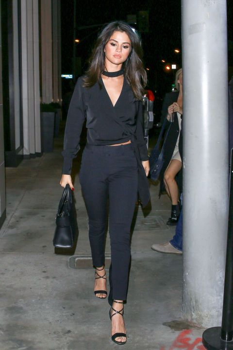 Selena Gomez pairs a chocker top with black skinnies and strappy heels for a sexy but simple look for a night out.