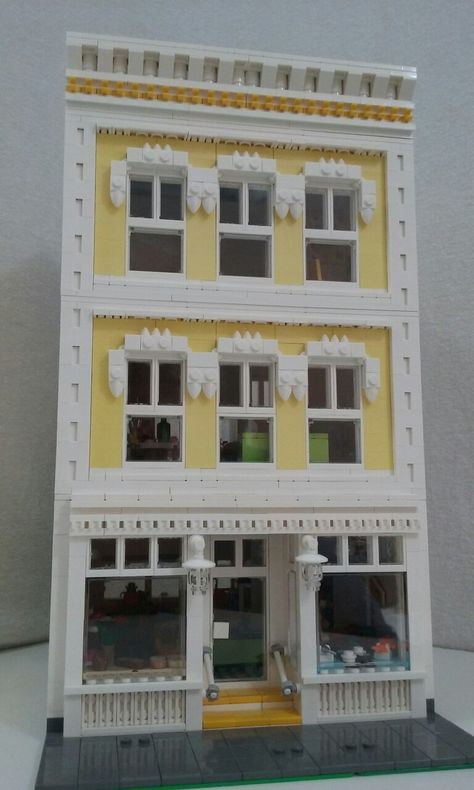 Lego,modular,front of yellow shop with house, 24 studs wide.  I really like the trim details!  Excellent MOC
