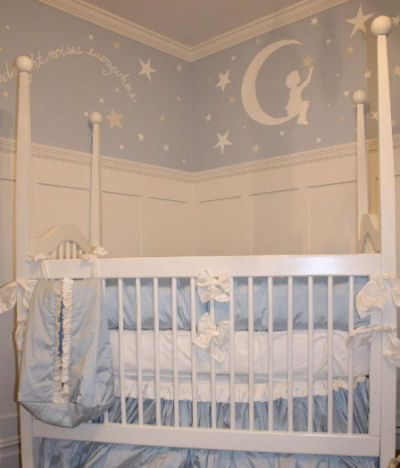A silver-y white and light baby blue boy nursery decorated in a Goodnight Moon and stars theme with a custom wall mural creates an atmosphere that is virtually guaranteed to lull your little one peacefully to sleep.
