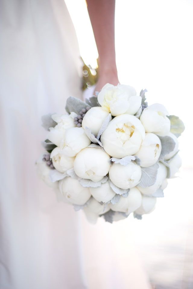 We designed the bridal bouquet with premium, fresh white peonies and complimented the peonies with dusty miller foliage.