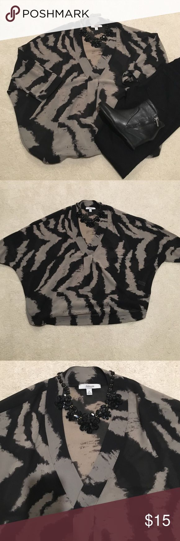 Zebra striped blouse This is a fun semi sheer dolman sleeve blouse with v-neck and zebra print. You definitely need a cami underneath. Looks great with jeans or dress pants for a night out. Tops Blouses