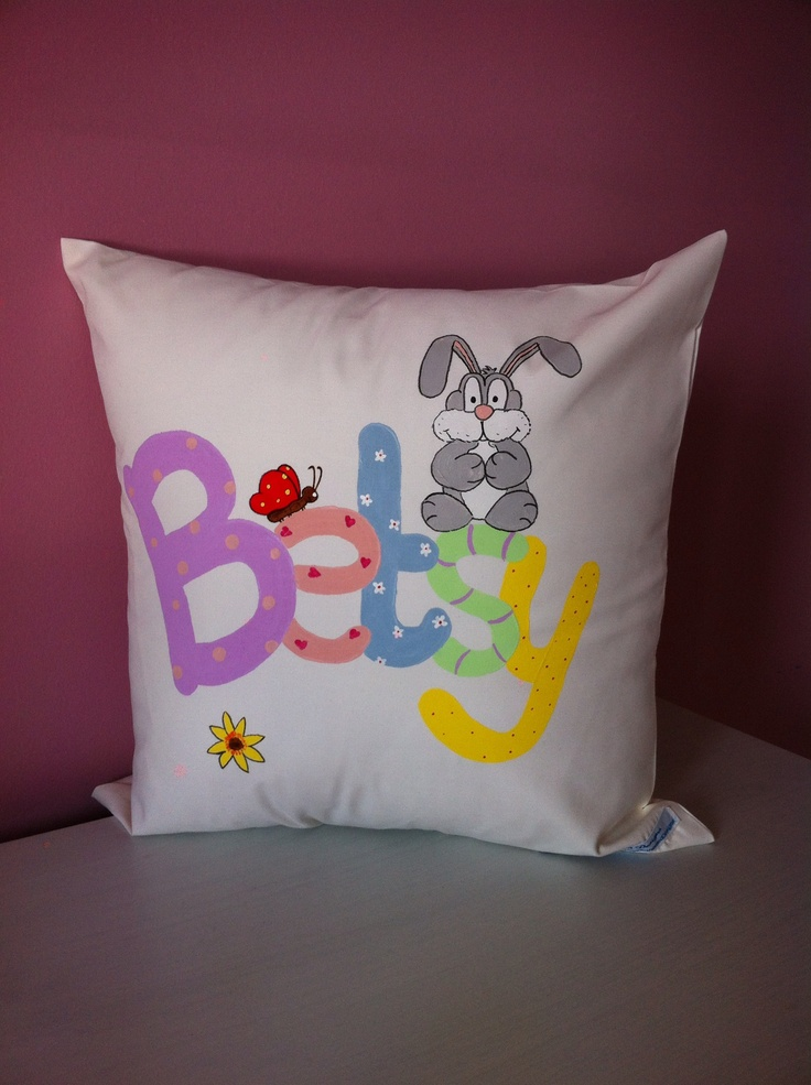 Newborn Betsy loves this cushion that brightens up her neutral nursery