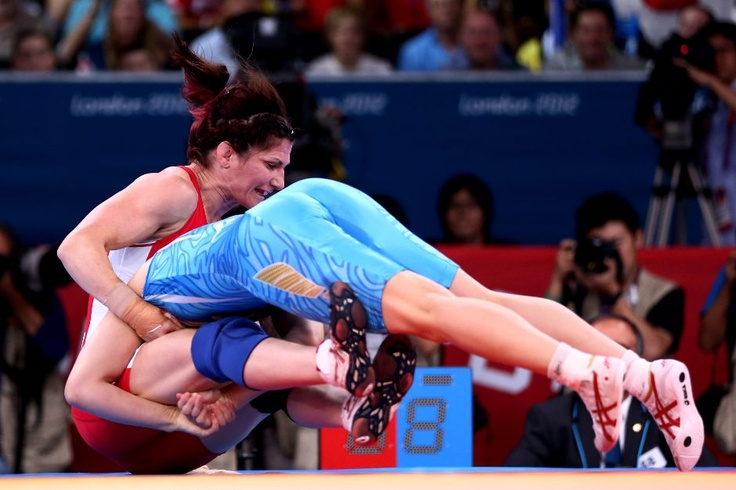 Saori Yoshida of Japan (blue) and Tonya Lynn Verbeek of Canada compete in the Women's Freestyle 55 kg Wrestling on Day 13 of the London 2012 Olympic Games at ExCeL on August 9, 2012 in London, England.