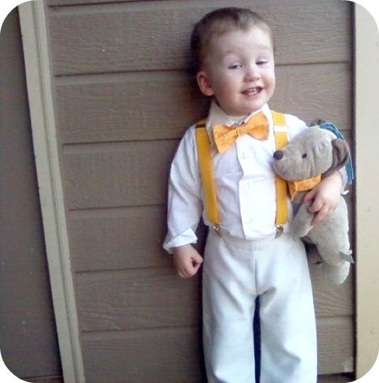 ring bearer with matching suspenders & bow tie to groomsmen colors