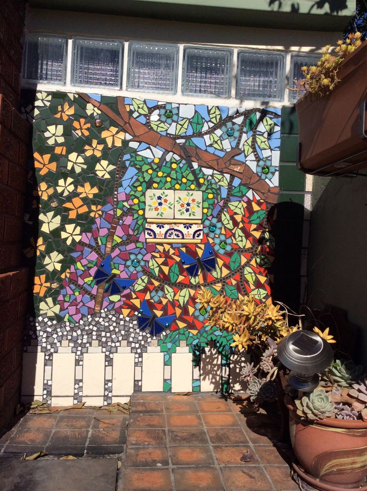 Glass and tile shed mosaic continued