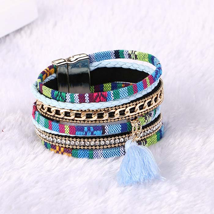 Ashanti Multilayer Tassle Bangle Bracelet - Light Blue  www.evcostudio.online  Gorgeous tapestry wrap bangle bracelets have so many facets to them from, rhinestones, gold chain, chord, tassles and more all stylishly finished off with a golden magnetised buckle.
