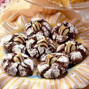As these cookies puff during baking, the chocolate appears through the powdered sugar, forming zebra stripes. Striped candy kisses enhance the effect./