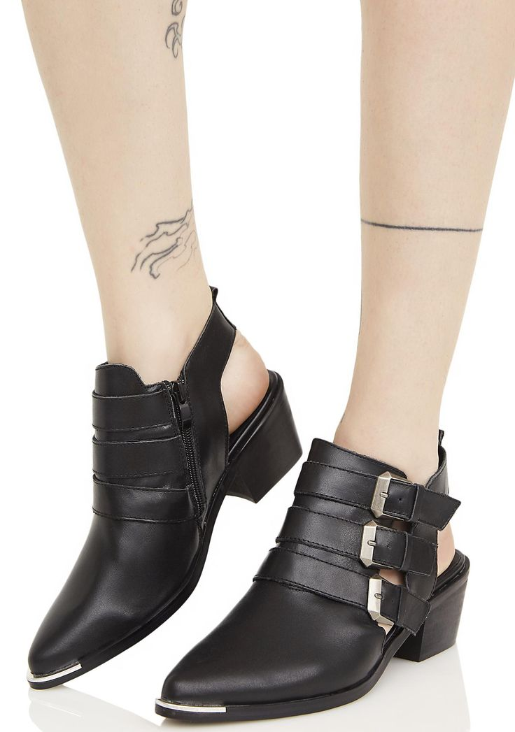 MTNG Nappa Cut-Out Bootie hey there desperado, is this town not big enough fer the two of ya? Take it to the streets in these sikk booties featuring adjustable triple buckles, metal toe plate, block heels, suede lining, cut out heel and side with zipper closure at the inner ankle.