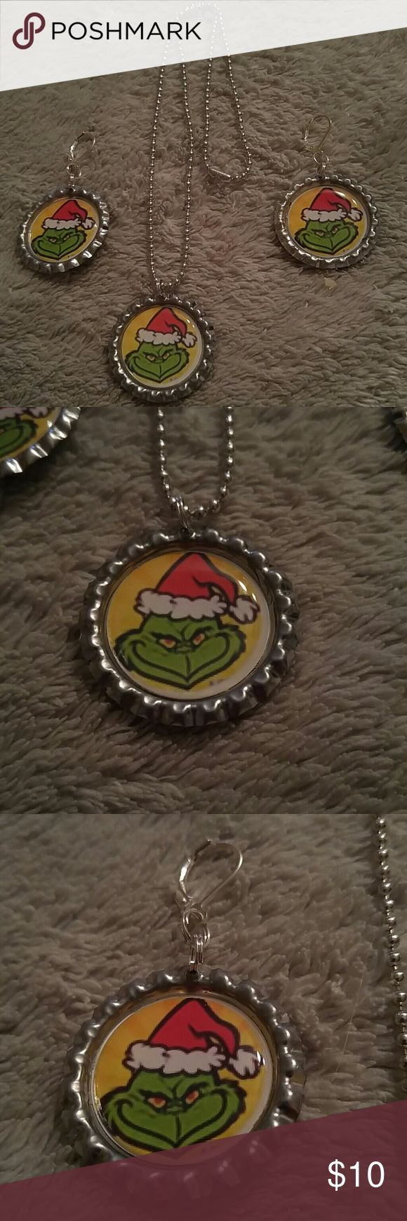 "The GRINCH Bottlecap Necklace & Earrings Set 1"" flattened silver Bottlecap necklace and earrings set with a picture of the GRINCH in a a Santa hat....comes on 18"" ball chain....Both Bottlecap and chain made of aluminum so they are lightweight. Jewelry Necklaces"