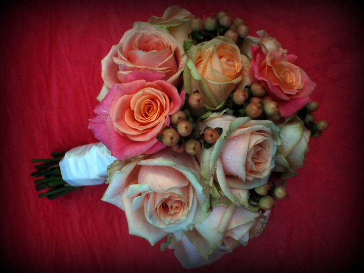 Bridal bouquet of miss piggy roses, pearl and peach avalanche roses with mellow peach hypericum.