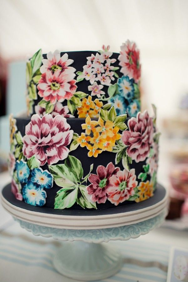 Whimsical black and floral wedding cake.