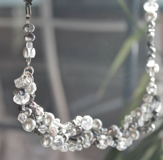 Necklace made of different beads in grey by Lisbethstafnedesigns