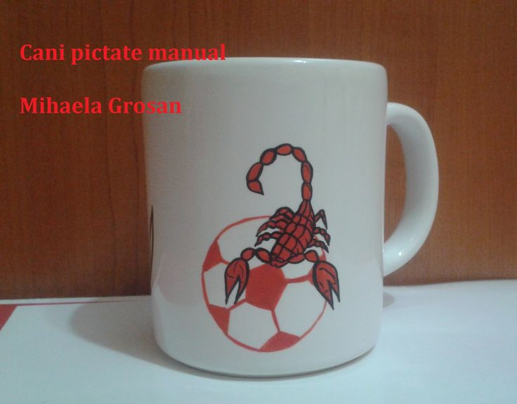 scorpion rosu pe o minge de fotbal rosie