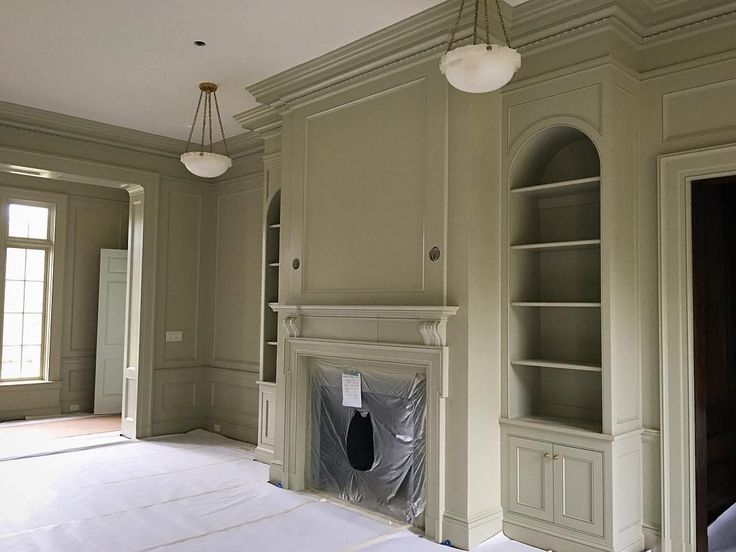 "cbrandoningramThe earthy gray green of @farrowandball ""vert de terre"" complements the millwork and detailing of this plantation library.."