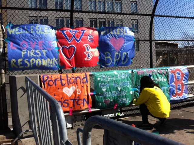 Memorial and supportive banners at the corner of Boylston