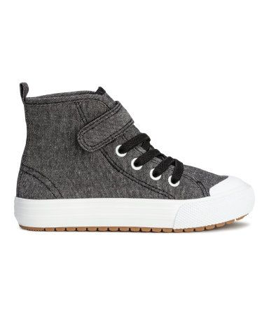 Black melange. High tops in cotton fabric with elasticized lacing, Velcro tab at top, and loop at back. Canvas lining, canvas insoles, and rubber soles.