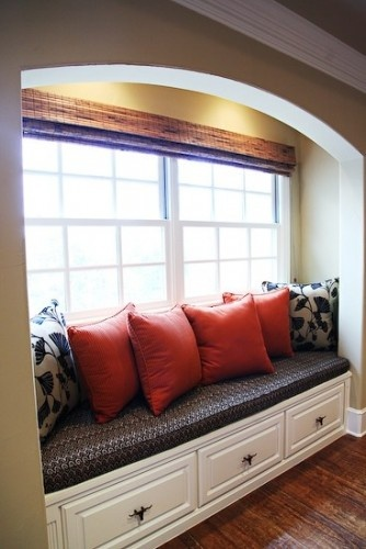 Use similar seating for the alcoves either side of the fireplace?