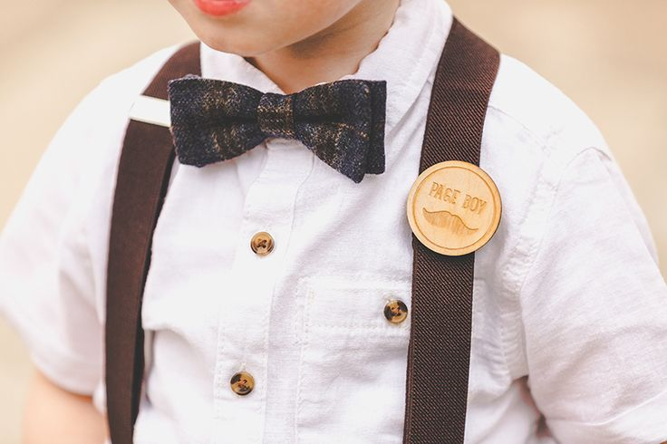 Super cute page boy accessory Maidens Barn wedding photography by Sam and Louise www.samandlouise.co.uk