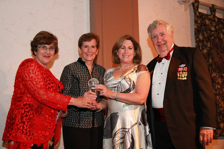 Sister Cities President Tom Halbert presents the One World Award to Shelly Fegel, national president of ORT International as the organization that has enhanced world understanding and respect through extraordinary work or volunteer service.