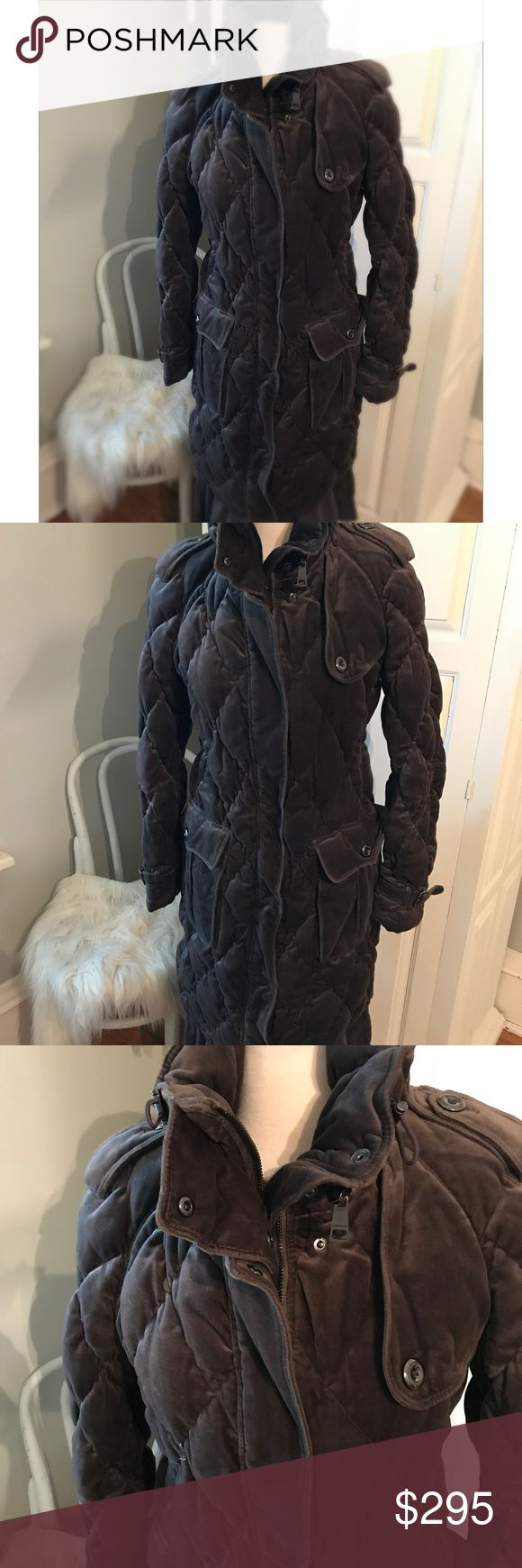 Authentic Burberry quilted Sift Chocolate Coat Duck down quilted in the most beautiful chocolate brown color. Super warm and classic style. Zipper hood, pockets and super soft. Very expensive coat originally. In gently used condition, please see pictures for a few minor spots, also feathers will naturally poke out once in awhile. The only thing wrong with it is the zipper isn't working all the time and is well worth the investment for someone to fix. Exquisite coat for those stylish winter…