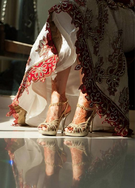 Indian bride flaunting these gorgeous golden ones! #beautifulbride #gorgeous #red #golden To see more: http://www.functionmania.com/blog/bridal-footwear-tips-buy-perfect-pair-shoes-wedding-day/